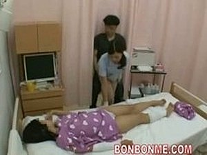 nurse handjob in front of wife 01